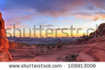 stock-photo-sweeping-sunset-panoramic-view-of-famous-delicate-arch-in-arches-national-park-in-moab-utah-hdr-109913006