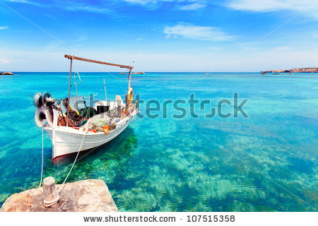 stock-photo-els-pujols-beach-in-formentera-with-traditional-fishing-boat-in-summer-day-107515358